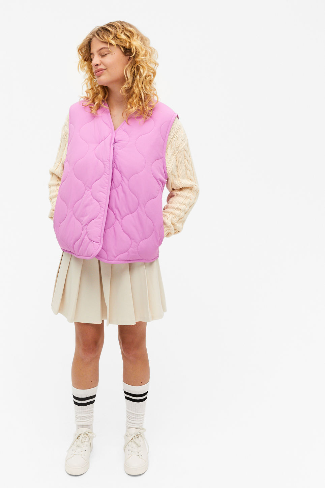 model wears purple Quilted vest from Monki