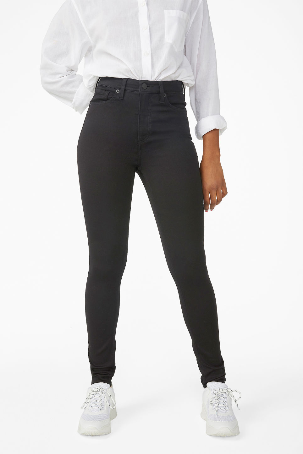 Model side image of Monki oki black deluxe jeans in black