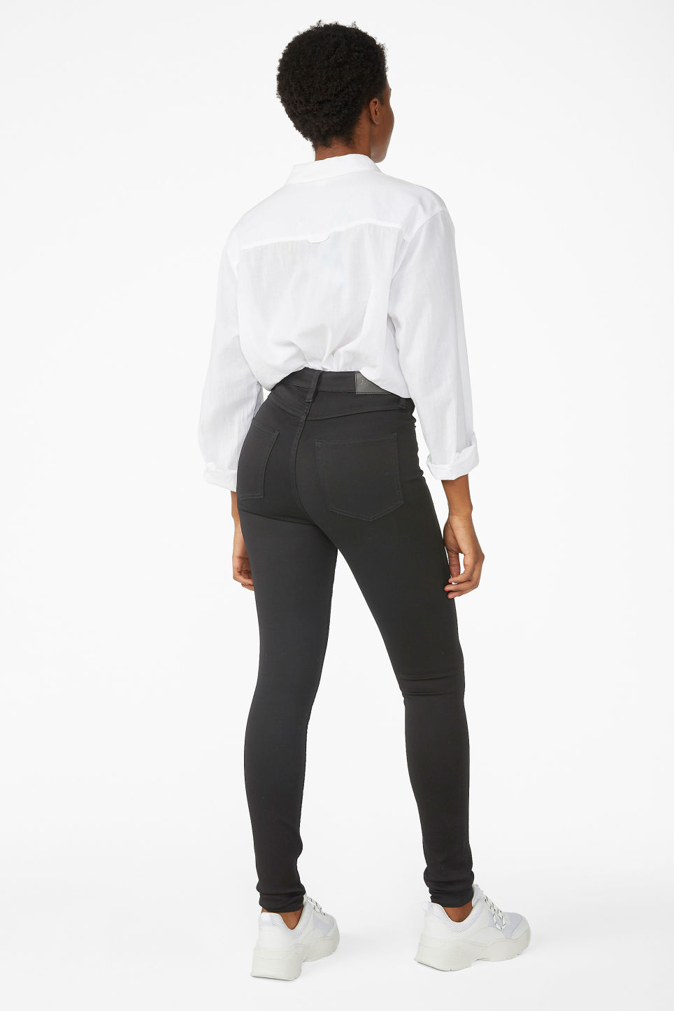 Model back image of Monki oki black deluxe jeans in black
