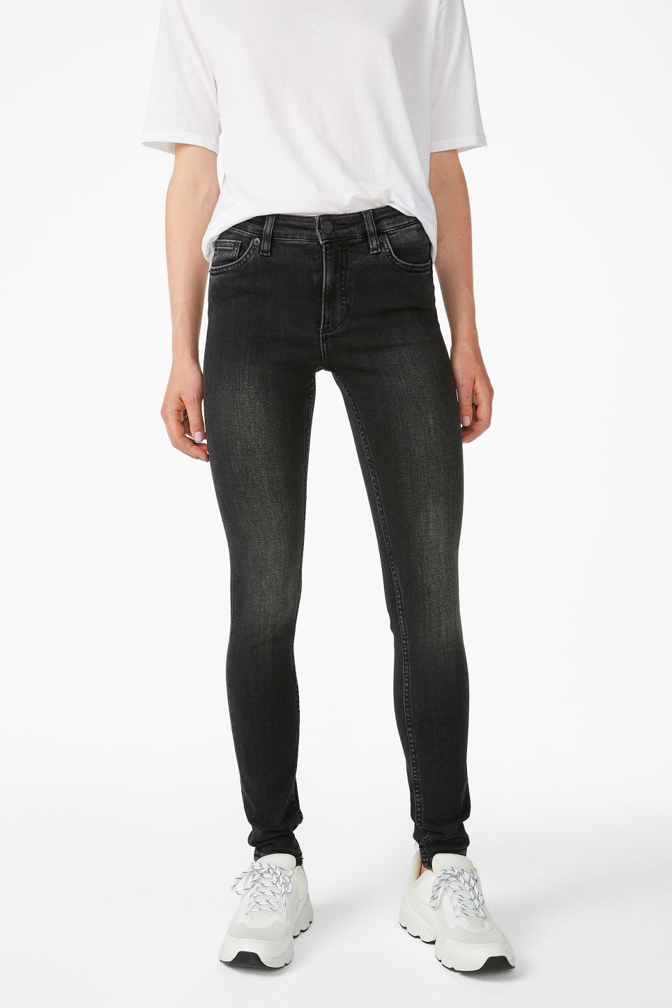 Model side image of Monki mocki washed black jeans in black