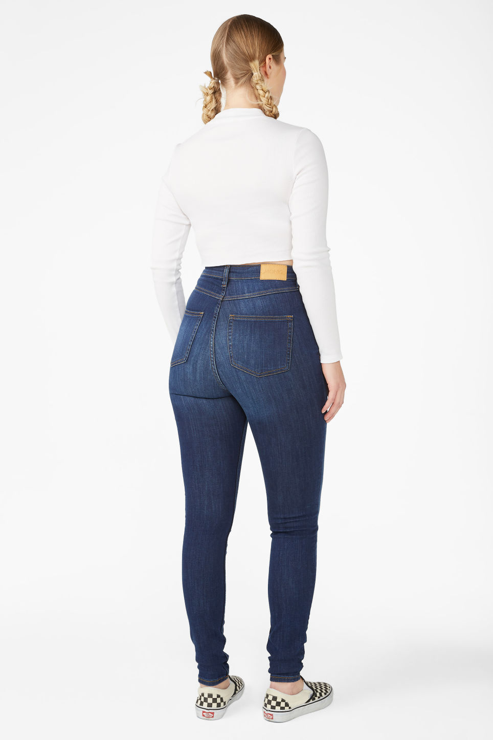 Model side image of Monki oki mid blue jeans in blue