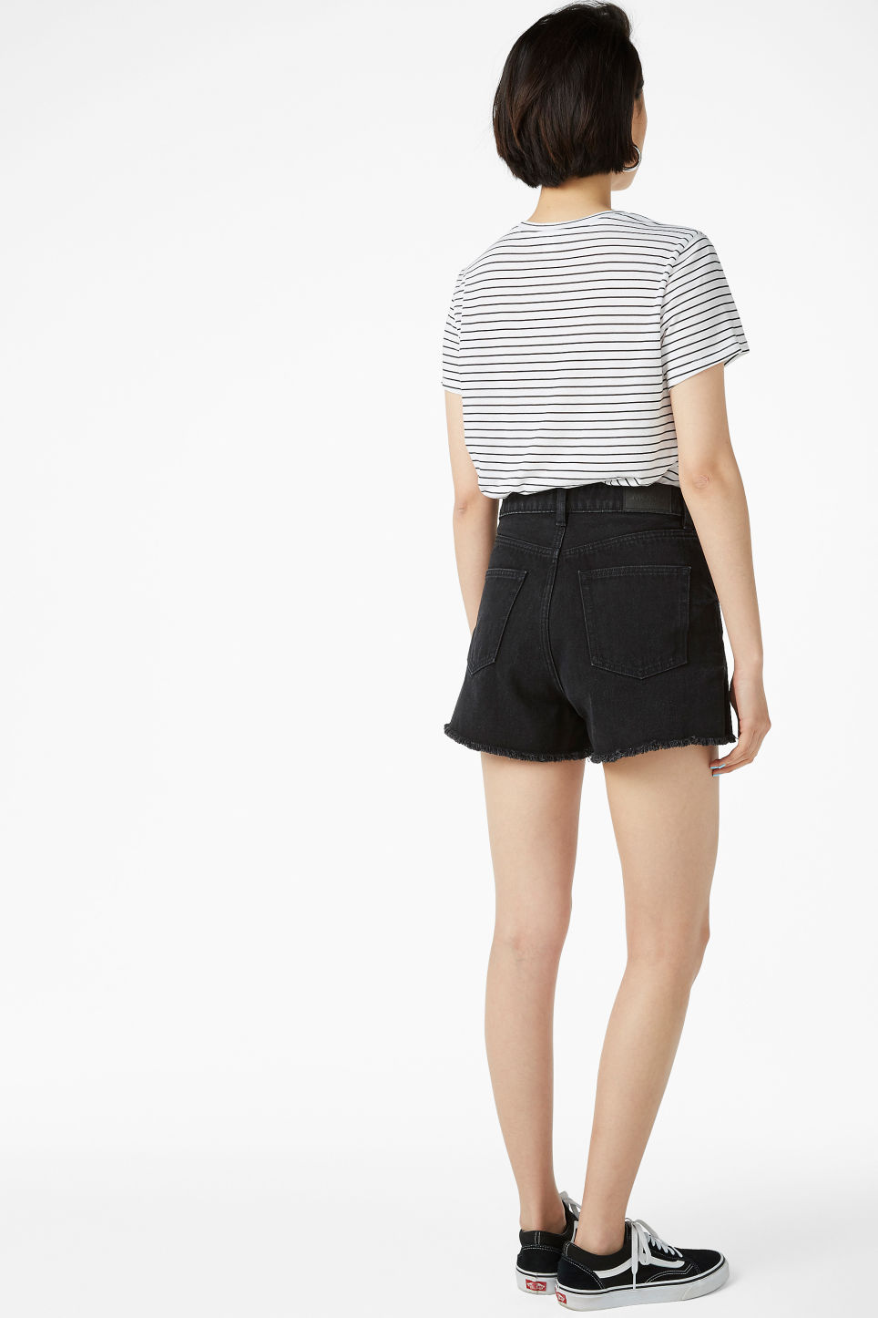 Model back image of Monki high waist denim shorts in black