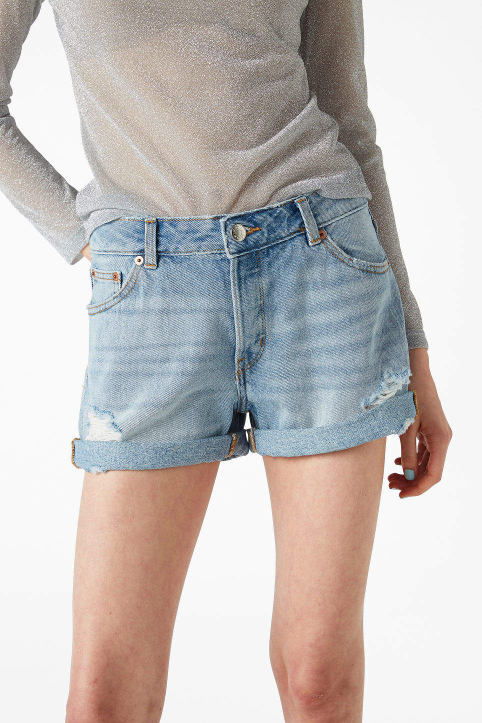 Model side image of Monki low waisted denim shorts in blue