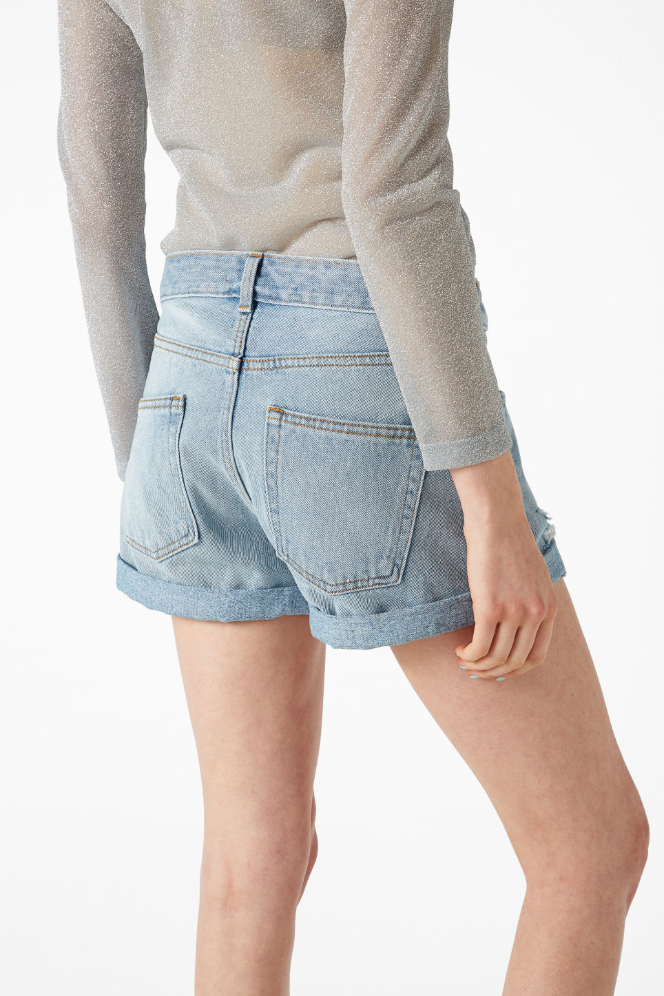 Model back image of Monki low waisted denim shorts in blue