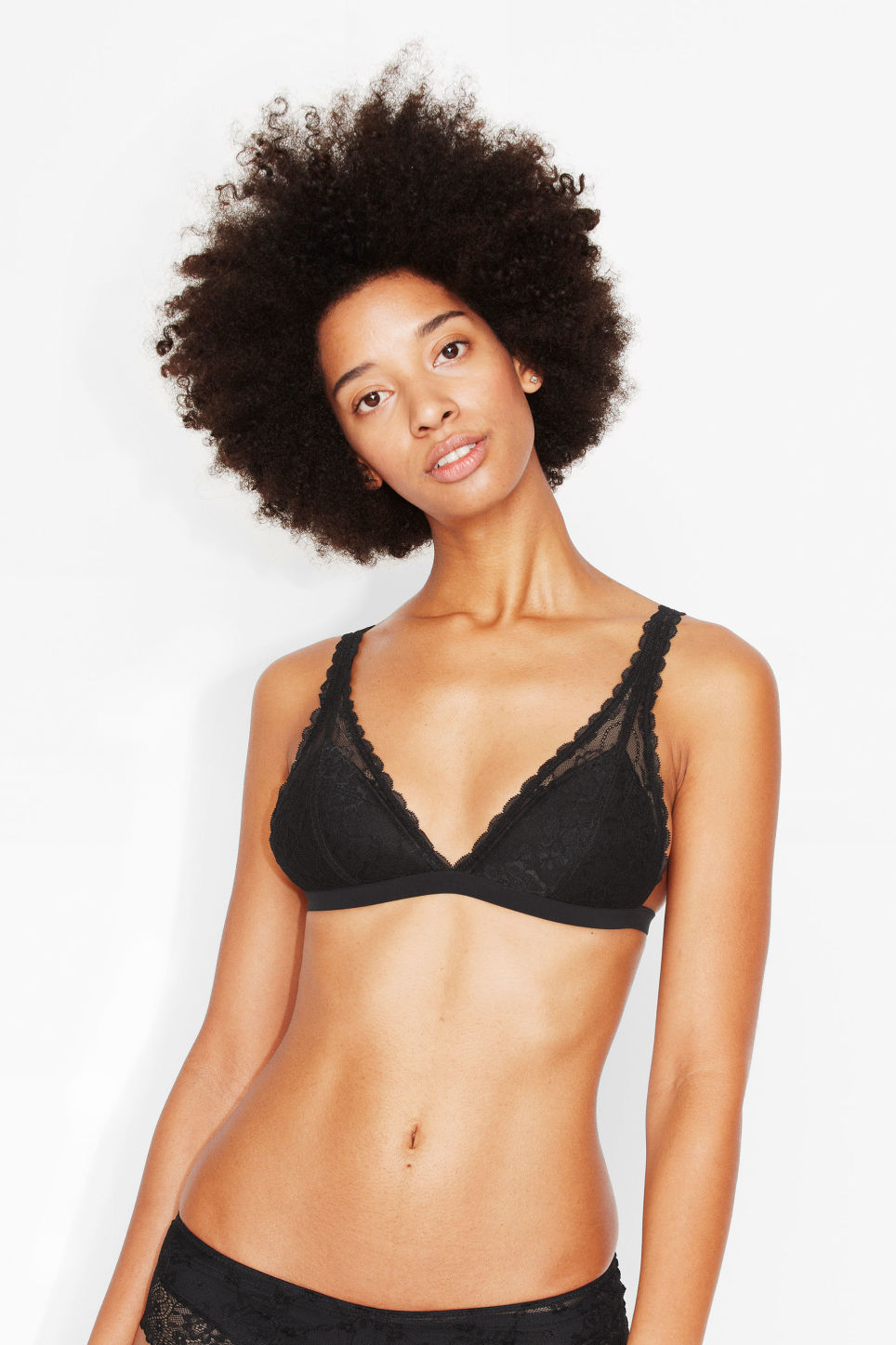 Model side image of Monki wire free lace bra in black