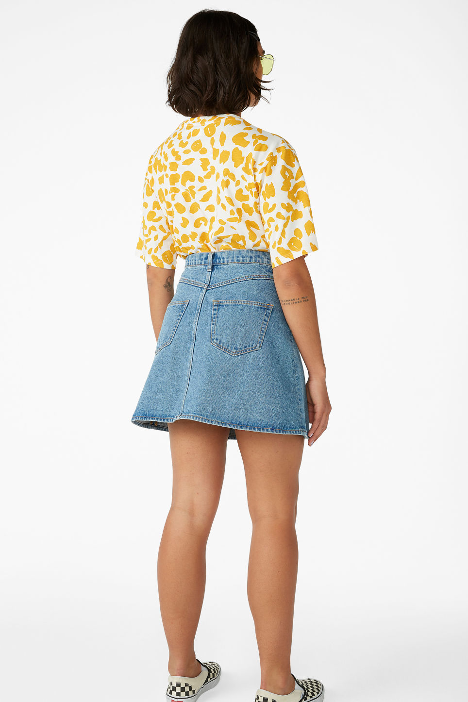 Model back image of Monki mini a-line denim skirt in blue