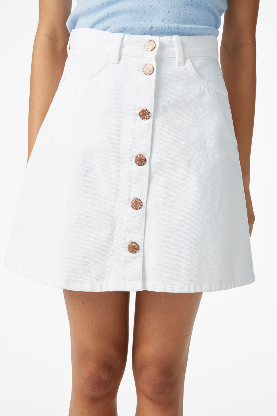 Model side image of Monki mini a-line denim skirt in white