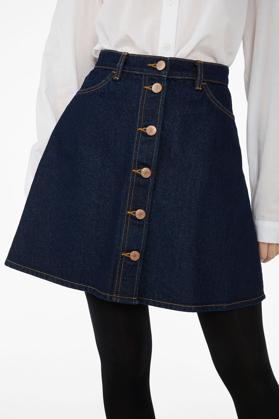 Model side image of Monki mini a-line denim skirt in blue