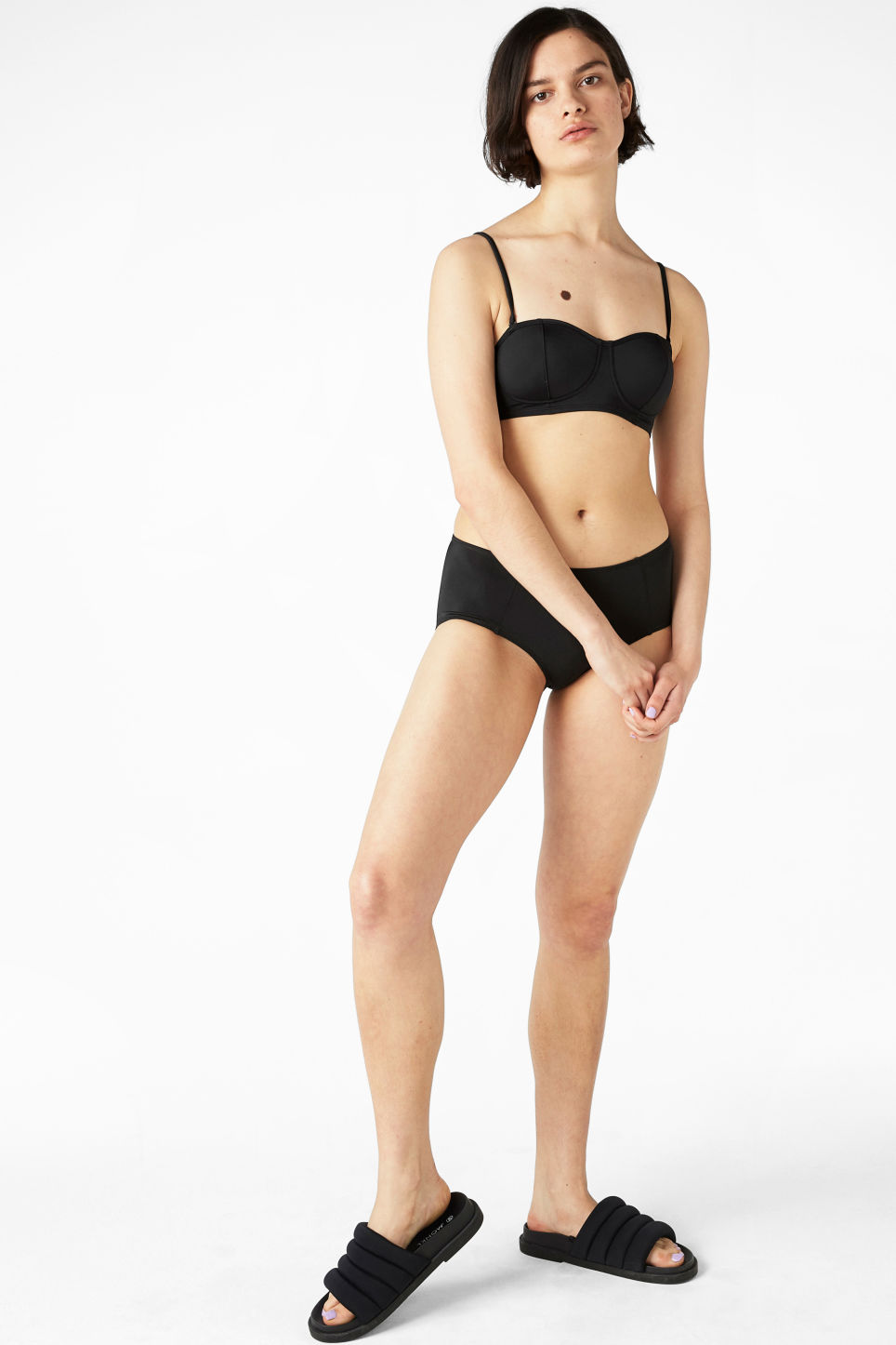 Model side image of Monki padded bikini top in black