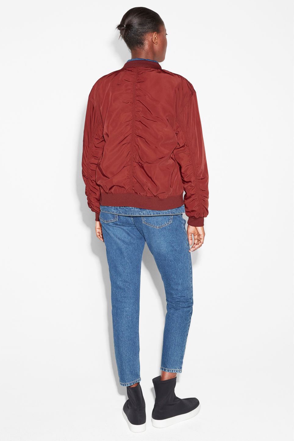 Model back image of Monki ruched seam bomber jacket in red