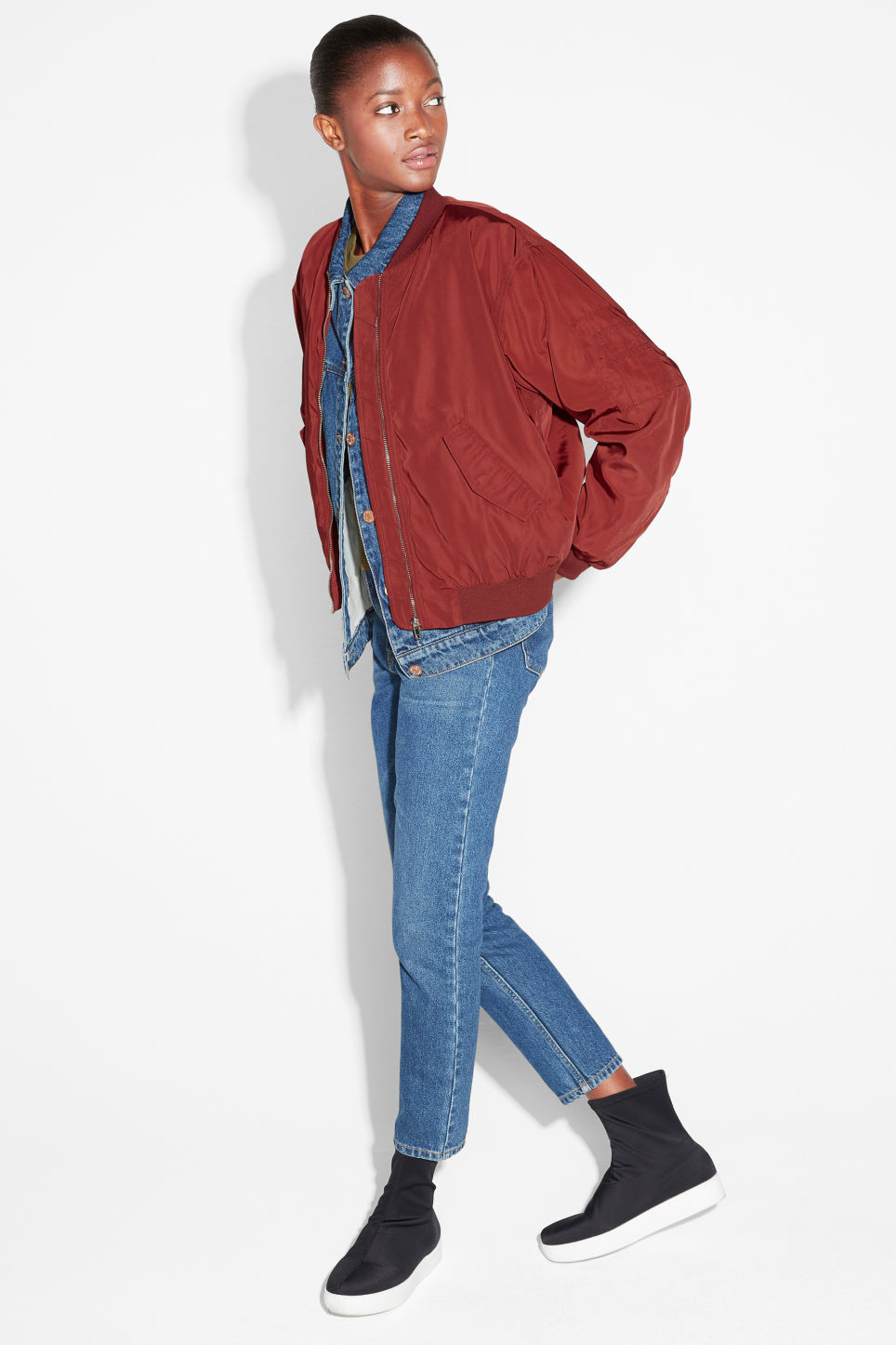 Model side image of Monki ruched seam bomber jacket in red