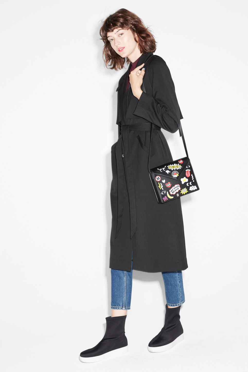 Model side image of Monki lightweight trench in black