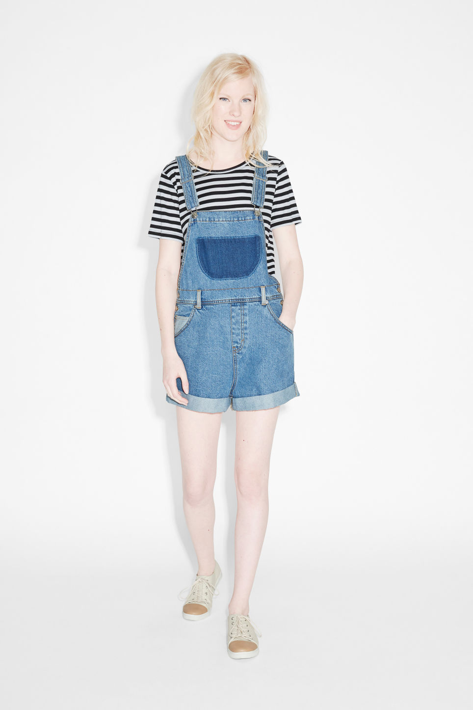 Model front image of Monki classic denim dungaree shorts in blue