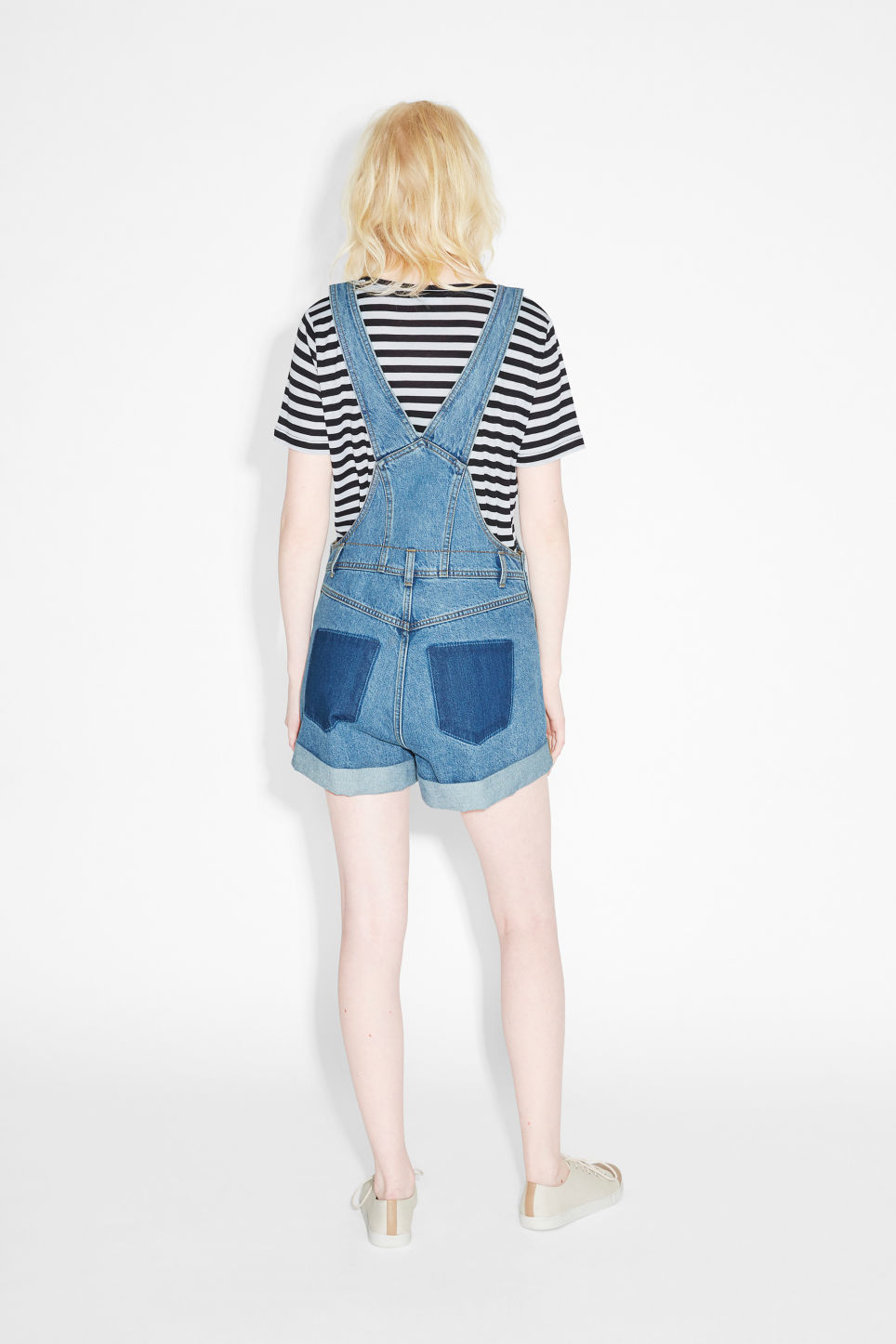 Model back image of Monki classic denim dungaree shorts in blue