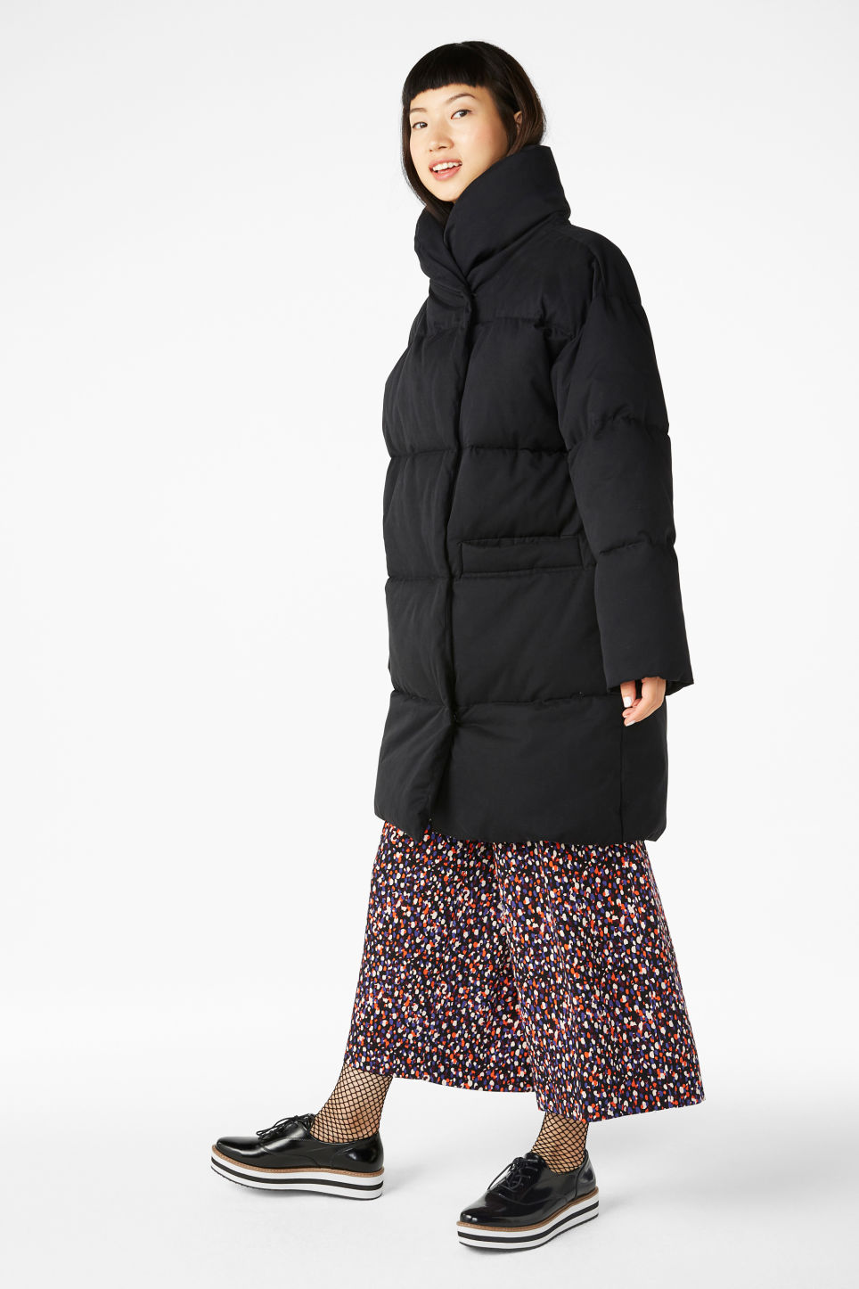 Model side image of Monki puff coat in black