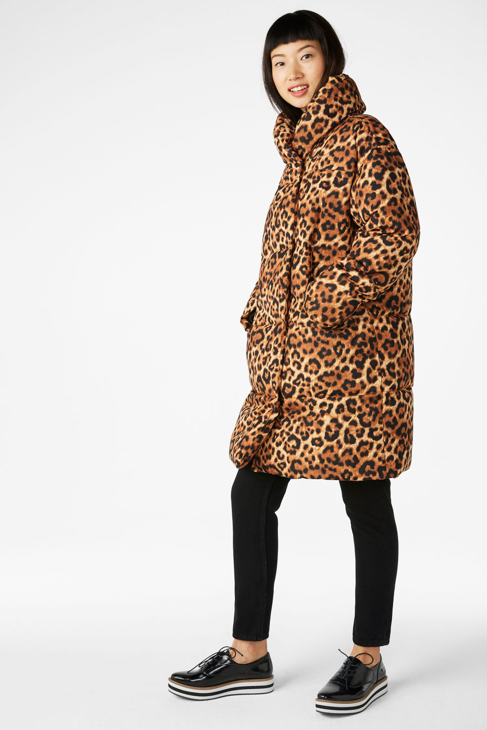 Model side image of Monki puff coat in yellow