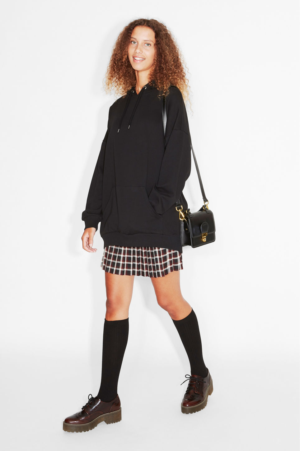 Model side image of Monki oversize hoodie in black