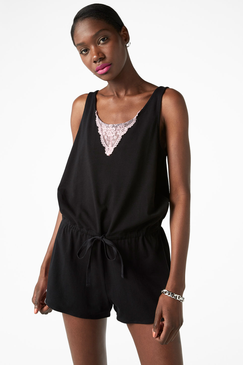 Model front image of Monki stretch cotton playsuit in black