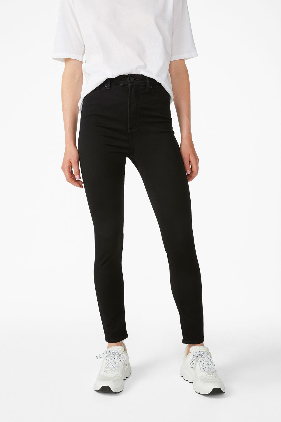Model side image of Monki oki cropped black deluxe jeans in black