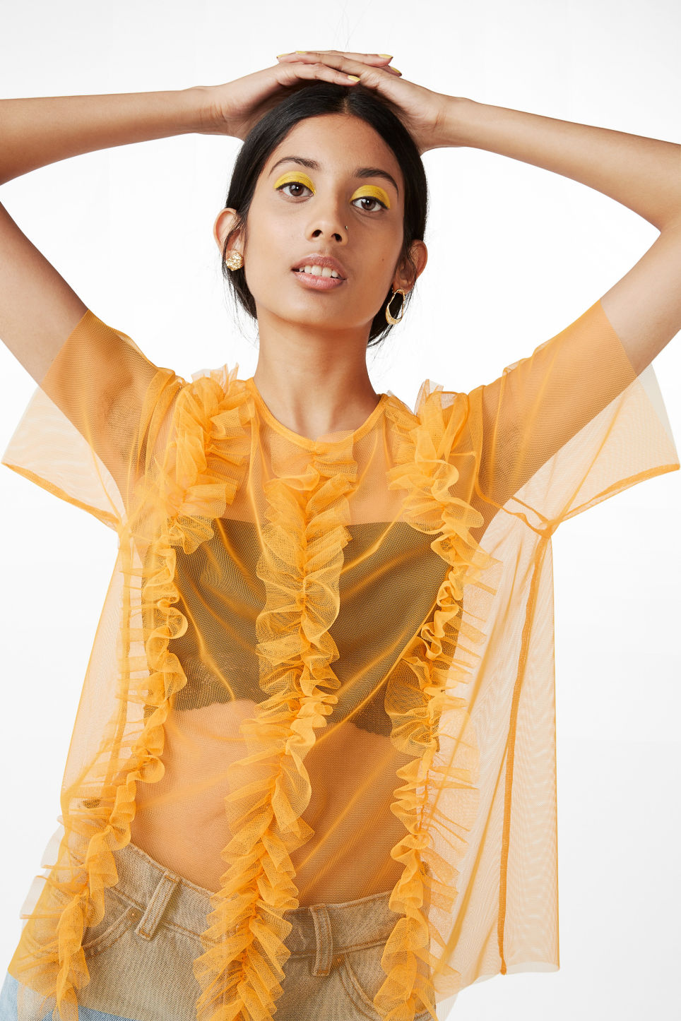 Model front image of Monki mesh ruffle top in yellow