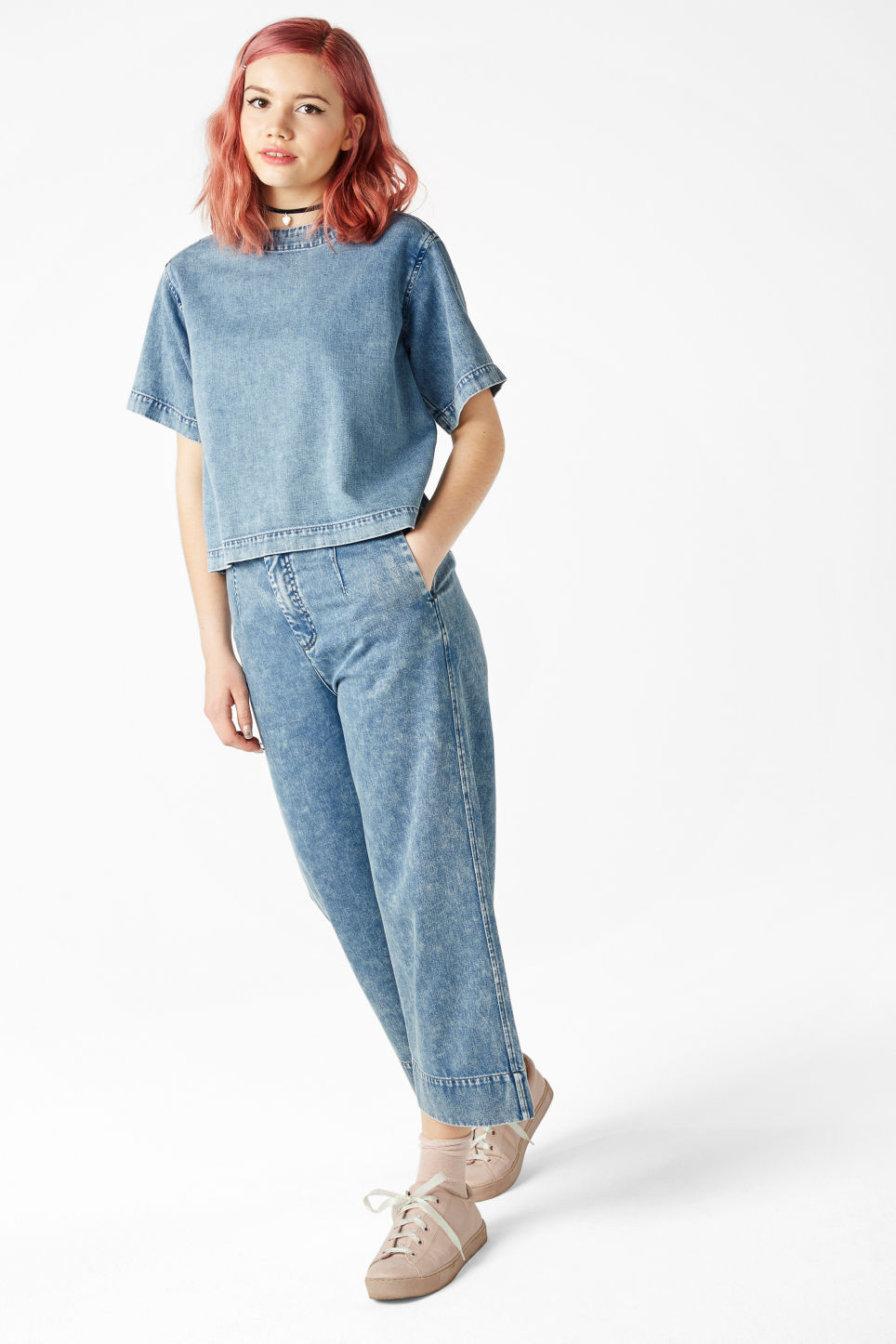 Model front image of Monki denim top in blue