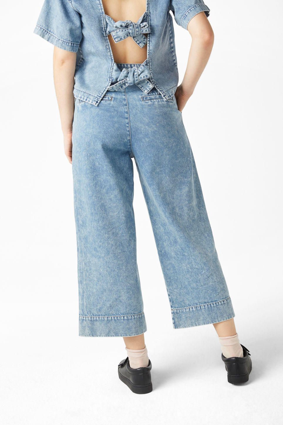 Model back image of Monki wide leg denim trousers in blue