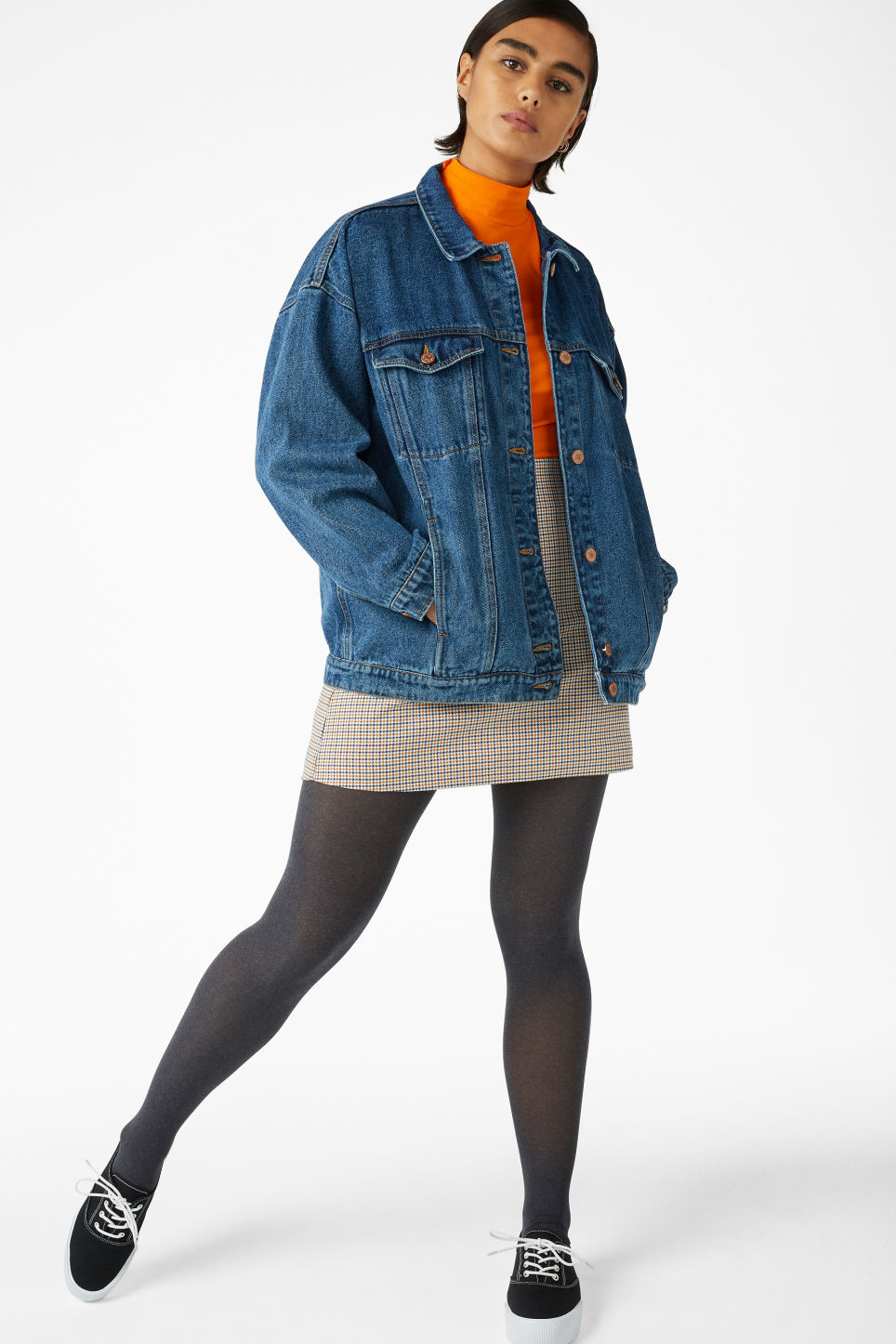 Model side image of Monki classic denim jacket in blue