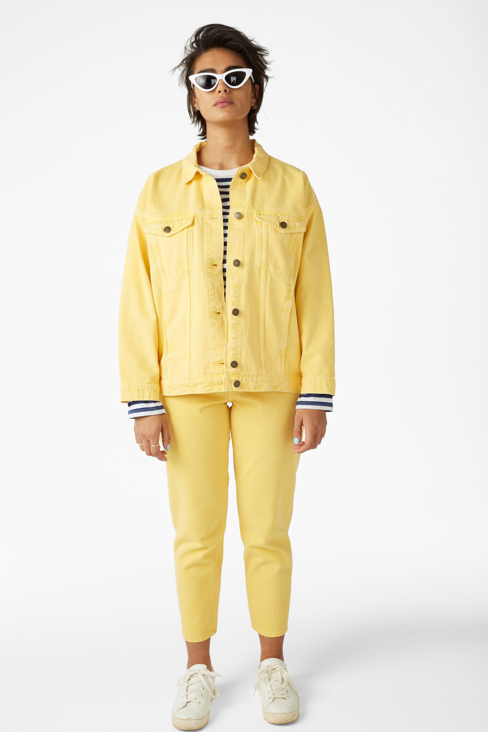 Model side image of Monki classic denim jacket in yellow