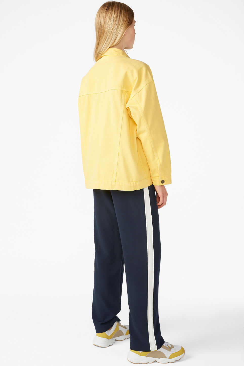Model back image of Monki classic denim jacket in yellow