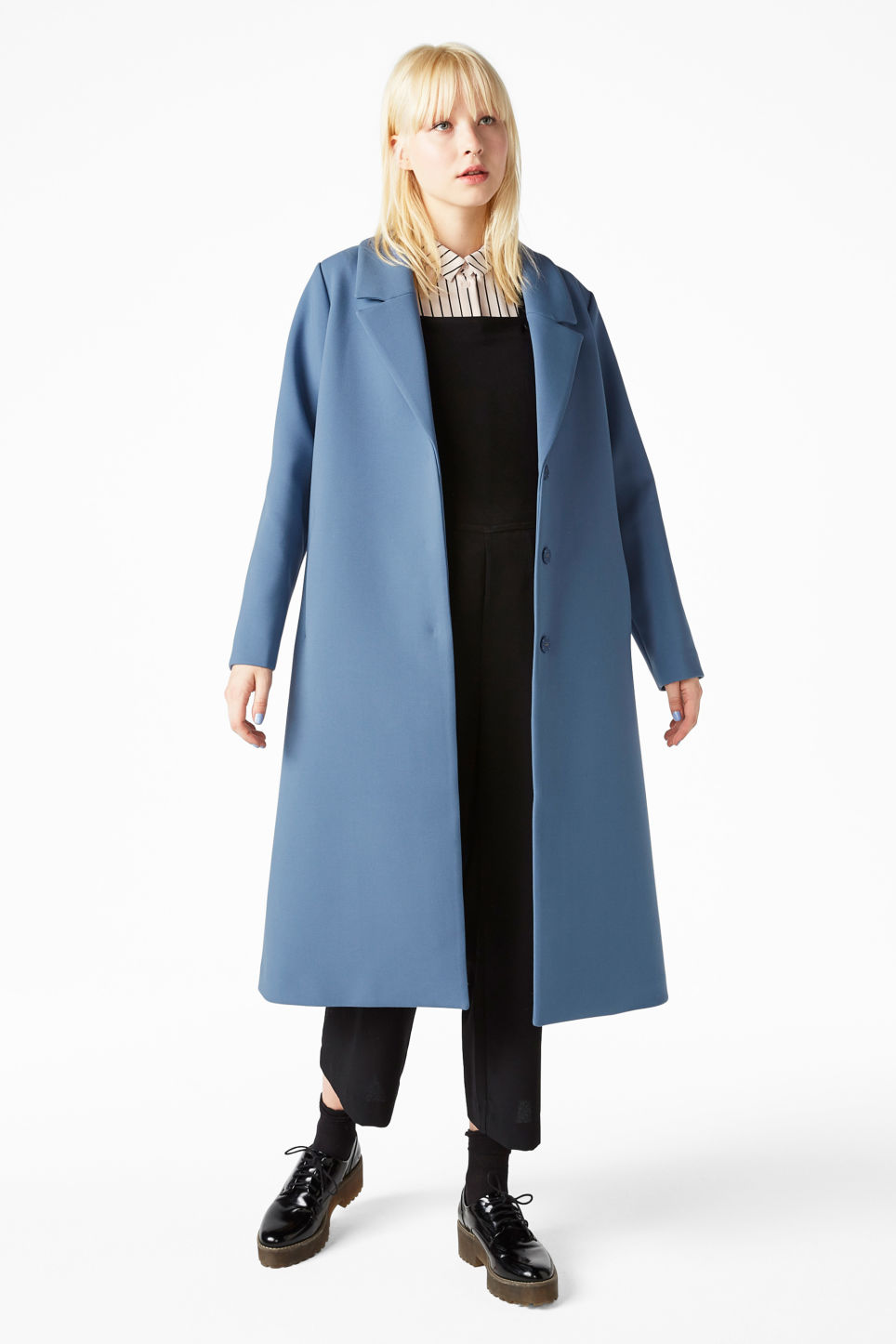 Model front image of Monki classic long coat in blue