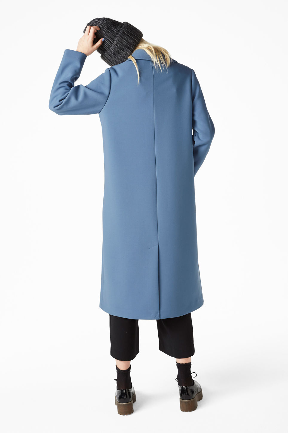 Model back image of Monki classic long coat in blue