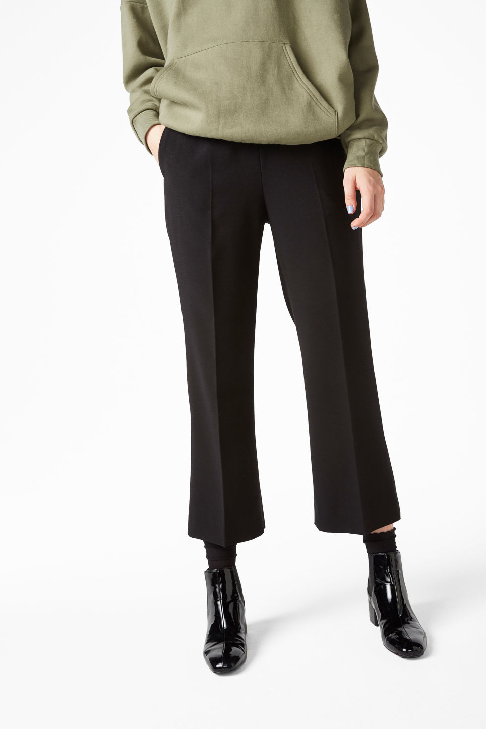 Model front image of Monki smart bootcut trousers in black