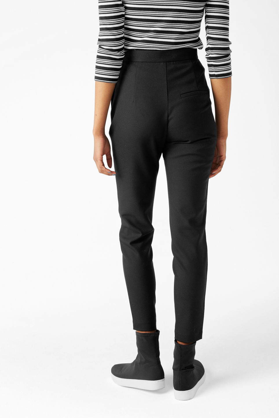 Model back image of Monki soft tapered trousers in black