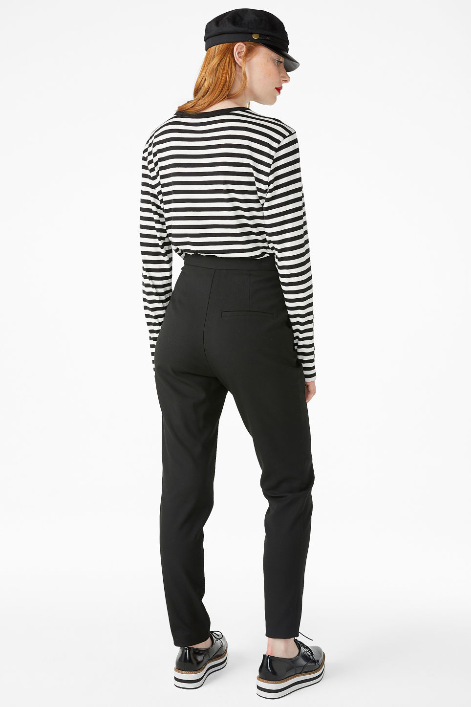 Model side image of Monki soft tapered trousers in black