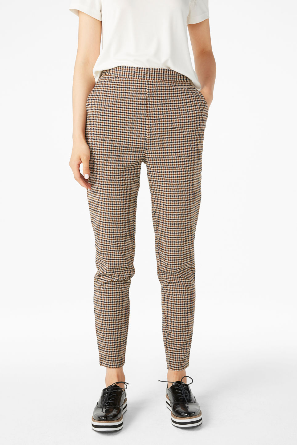 Model front image of Monki soft tapered trousers in yellow