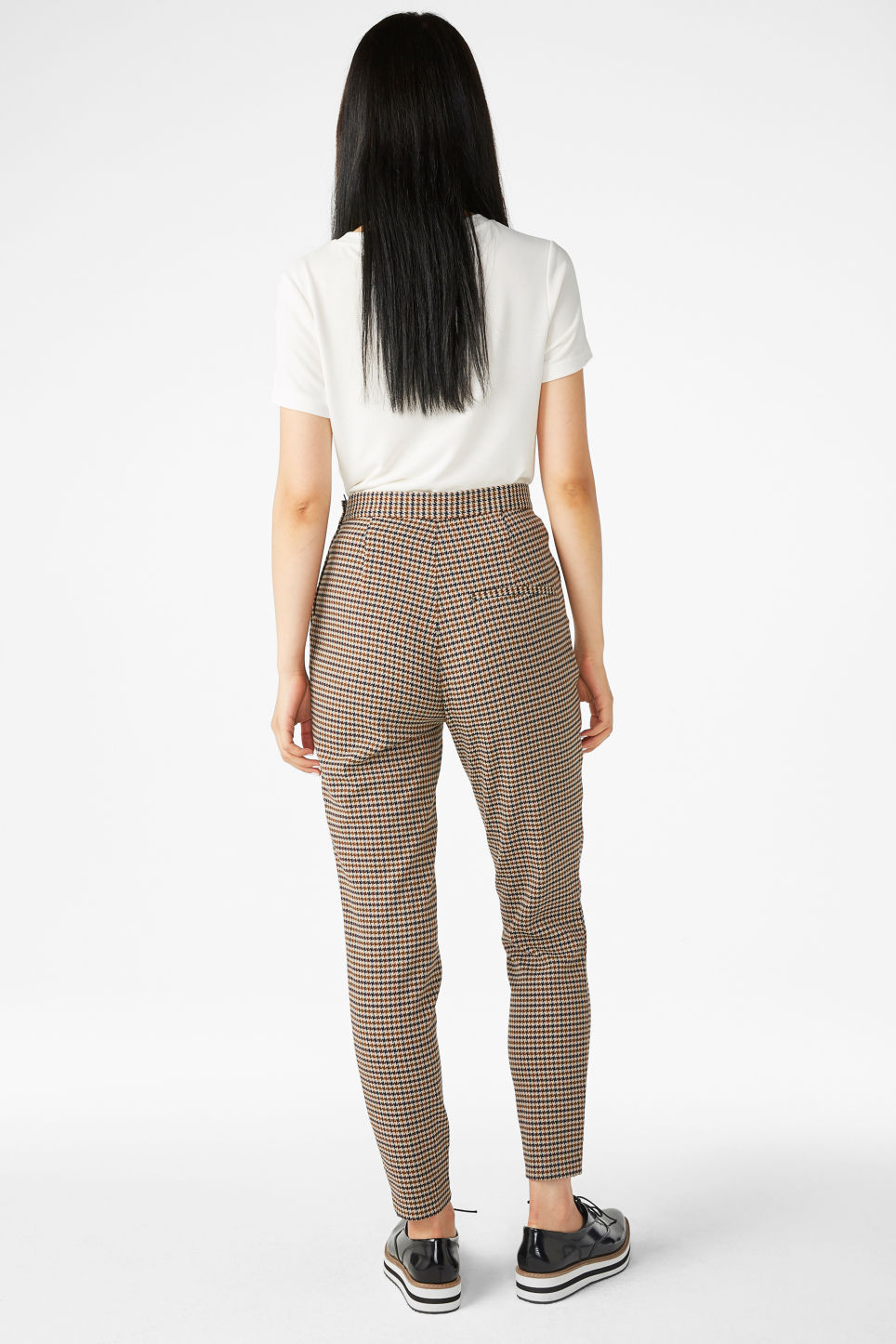Model back image of Monki soft tapered trousers in yellow