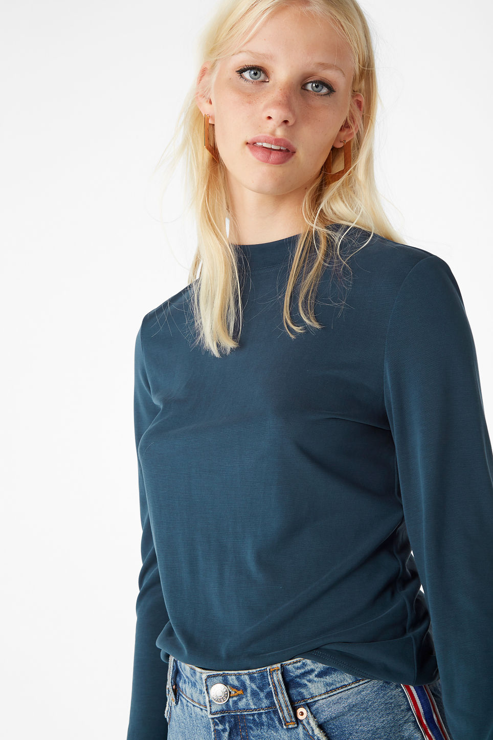 Model side image of Monki super-soft long sleeve top in blue