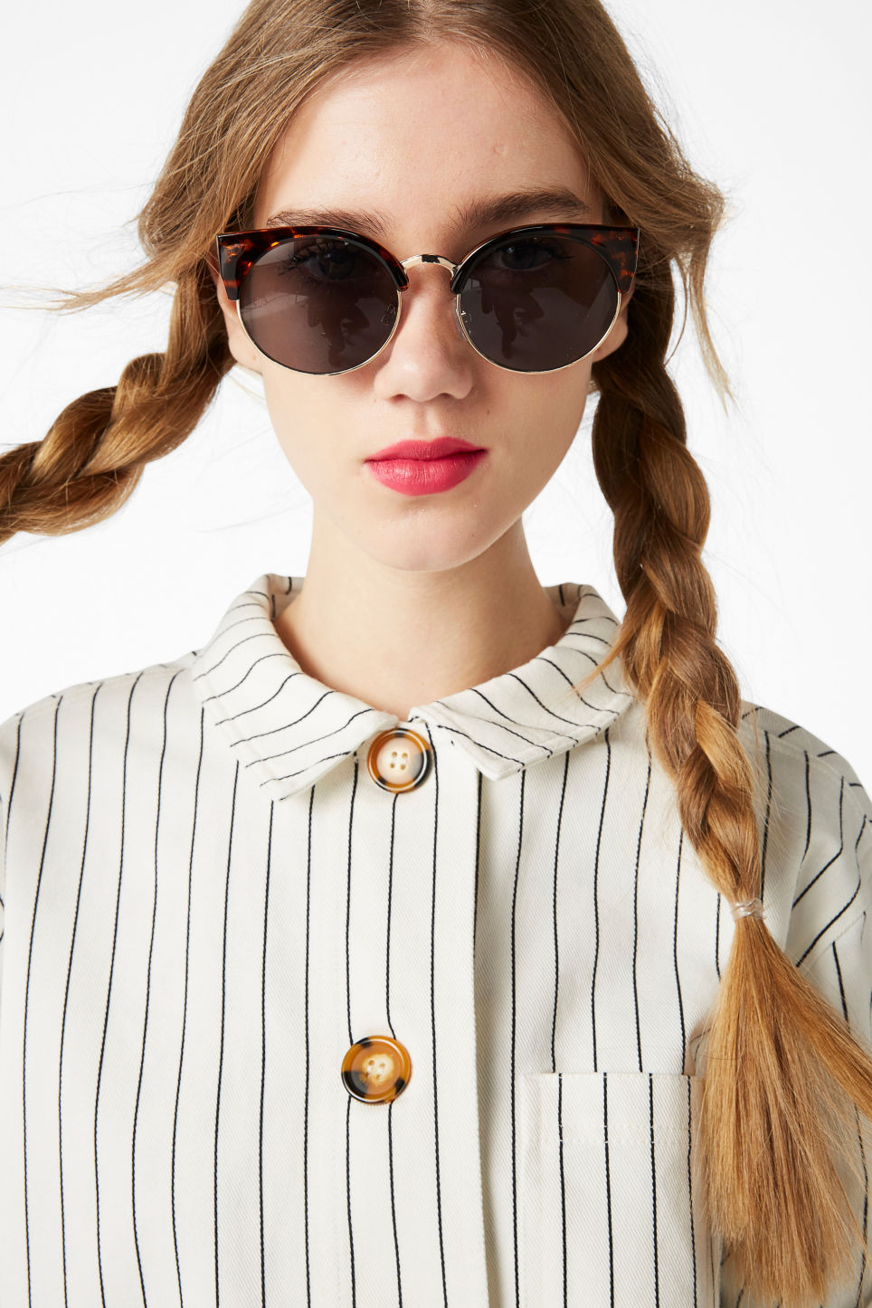 Model side image of Monki cat-eye sunglasses in brown