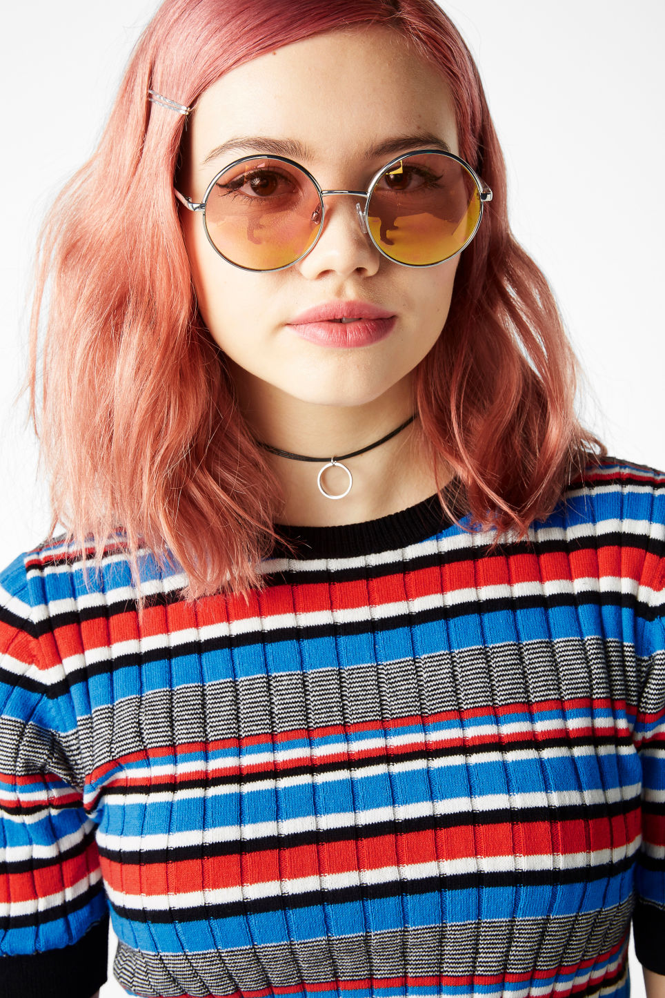 Model side image of Monki 70s style sunglasses in silver