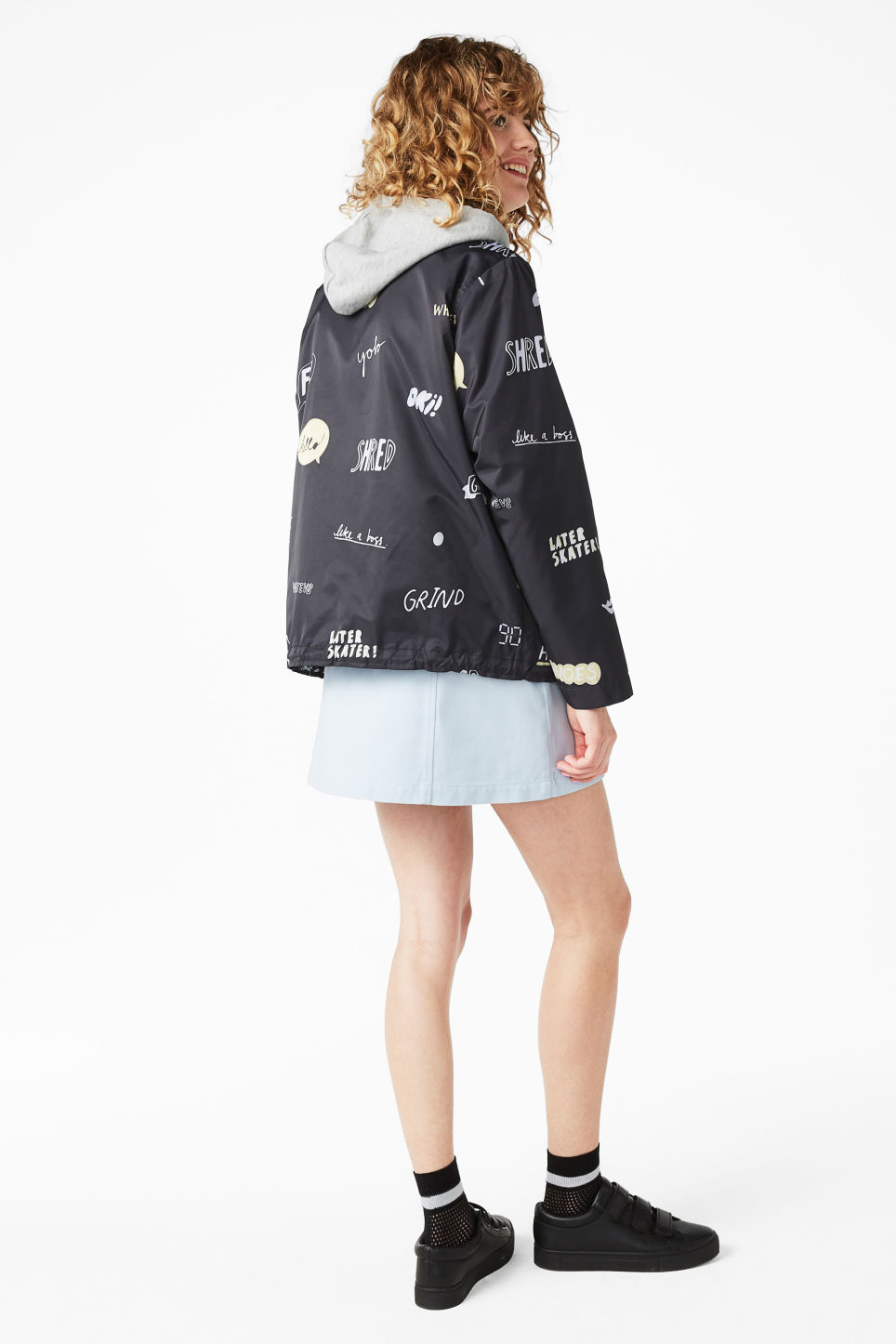 Model side image of Monki statement print windbreaker in black
