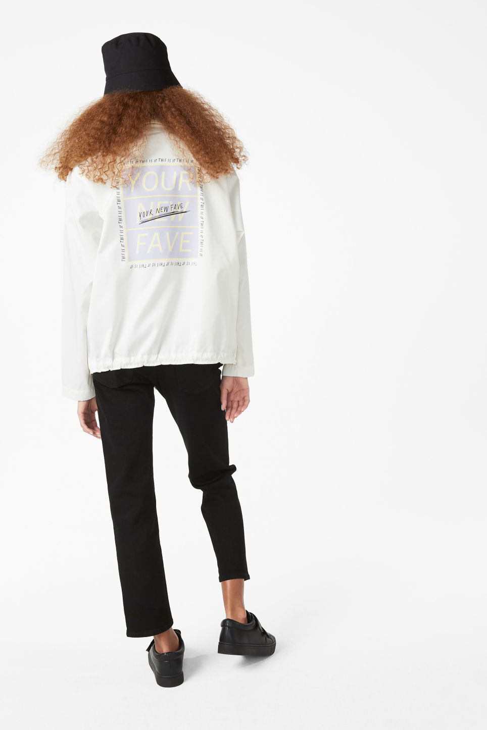 Model back image of Monki statement print windbreaker in white