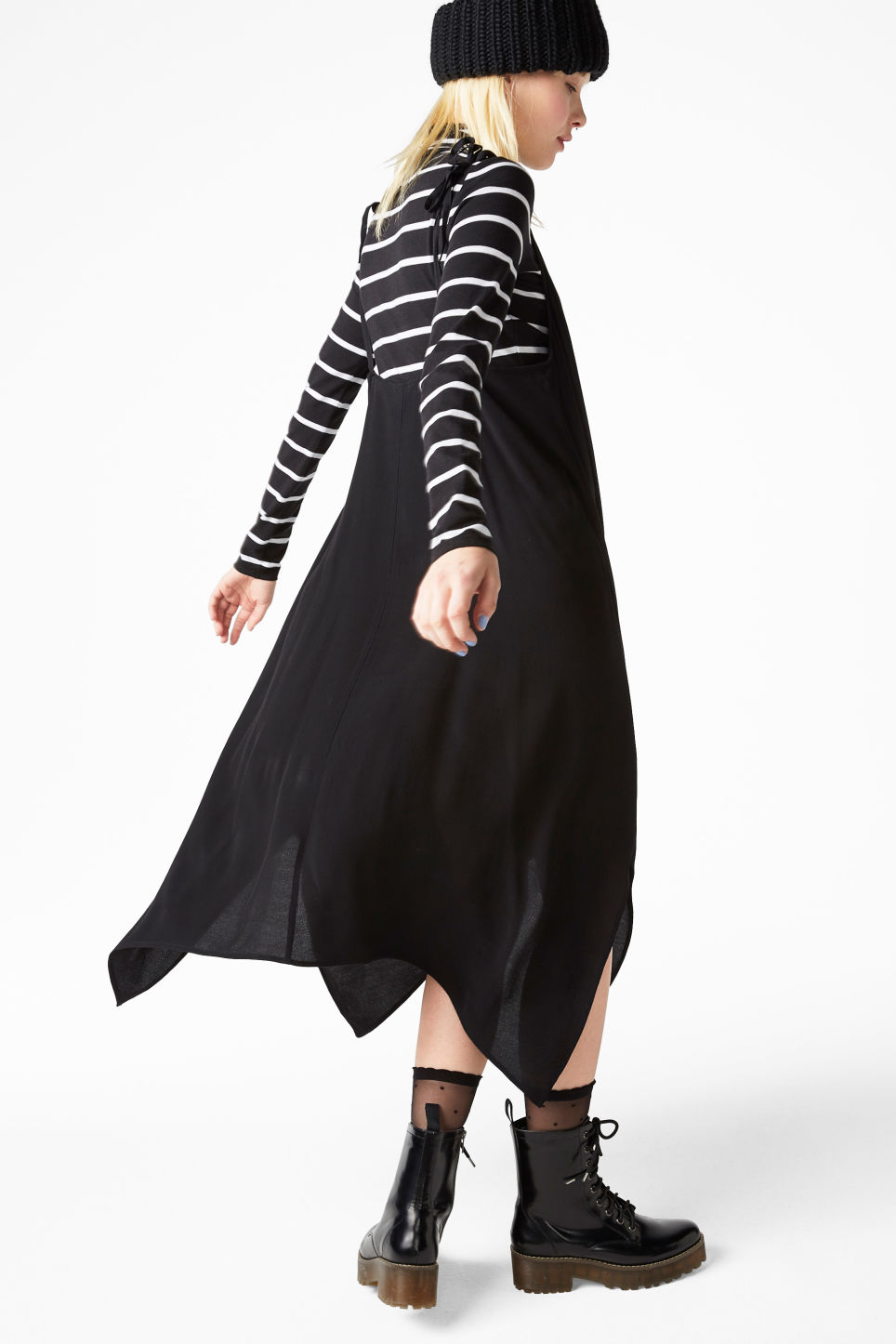 Model side image of Monki asymmetric slip dress in black