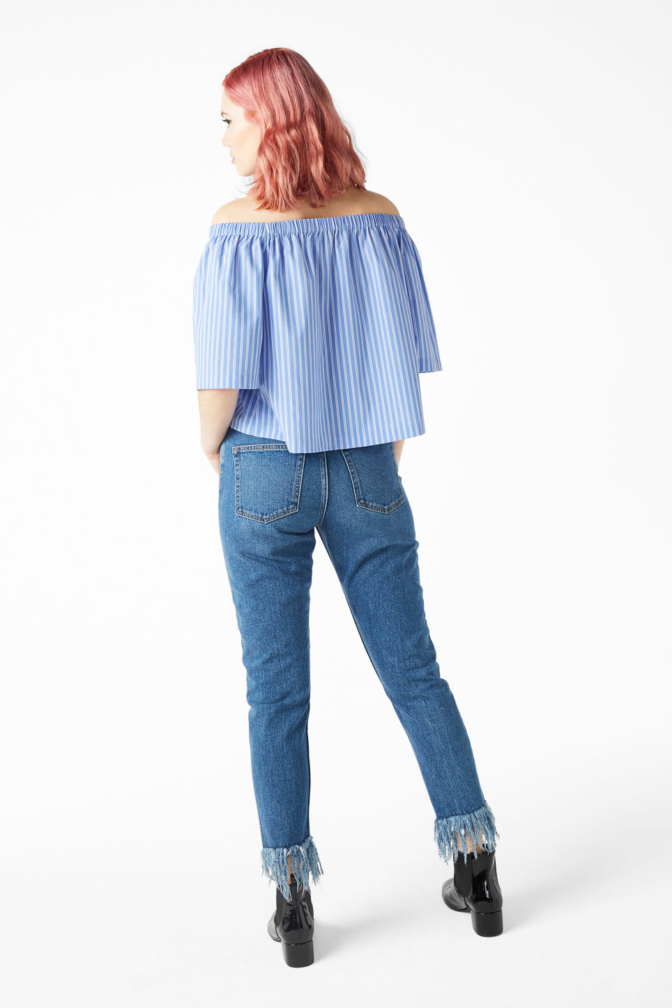 Model back image of Monki on/off shoulder blouse in blue