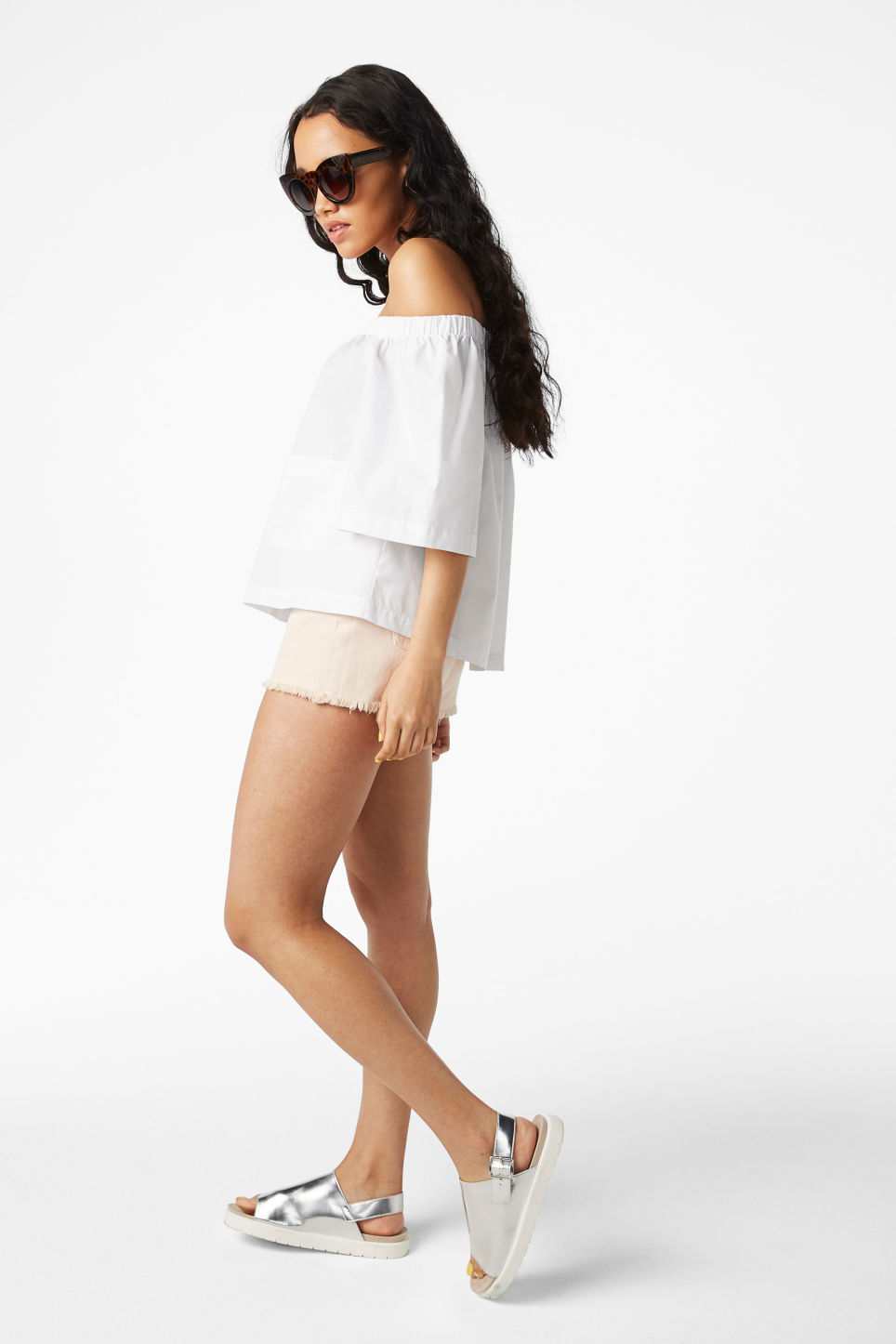 Model side image of Monki on/off shoulder blouse in white