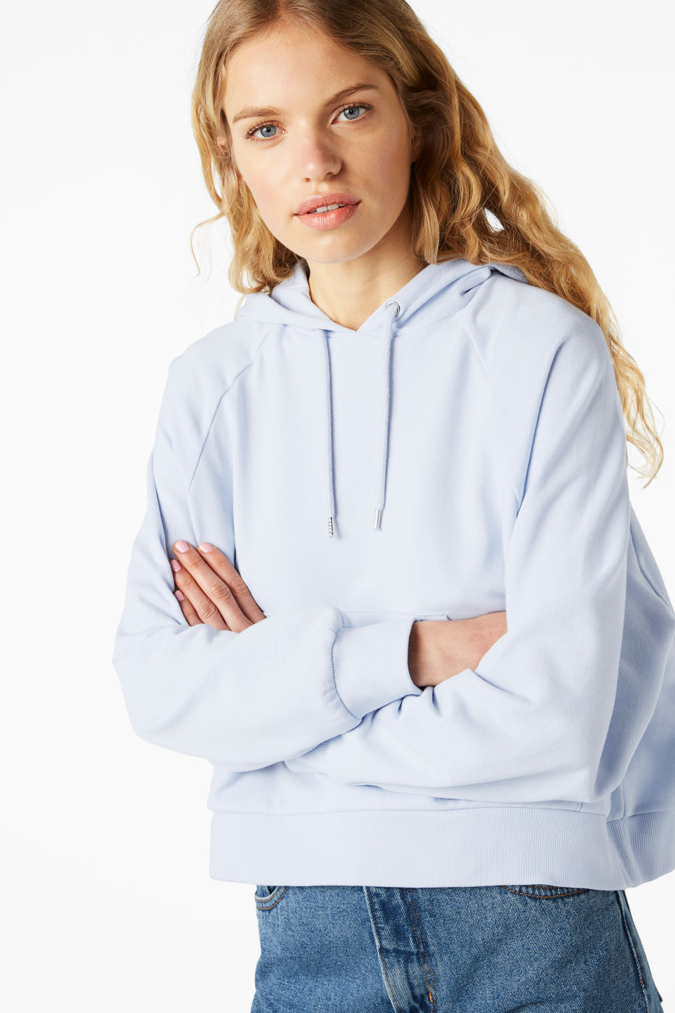 Model front image of Monki cropped hoodie in blue