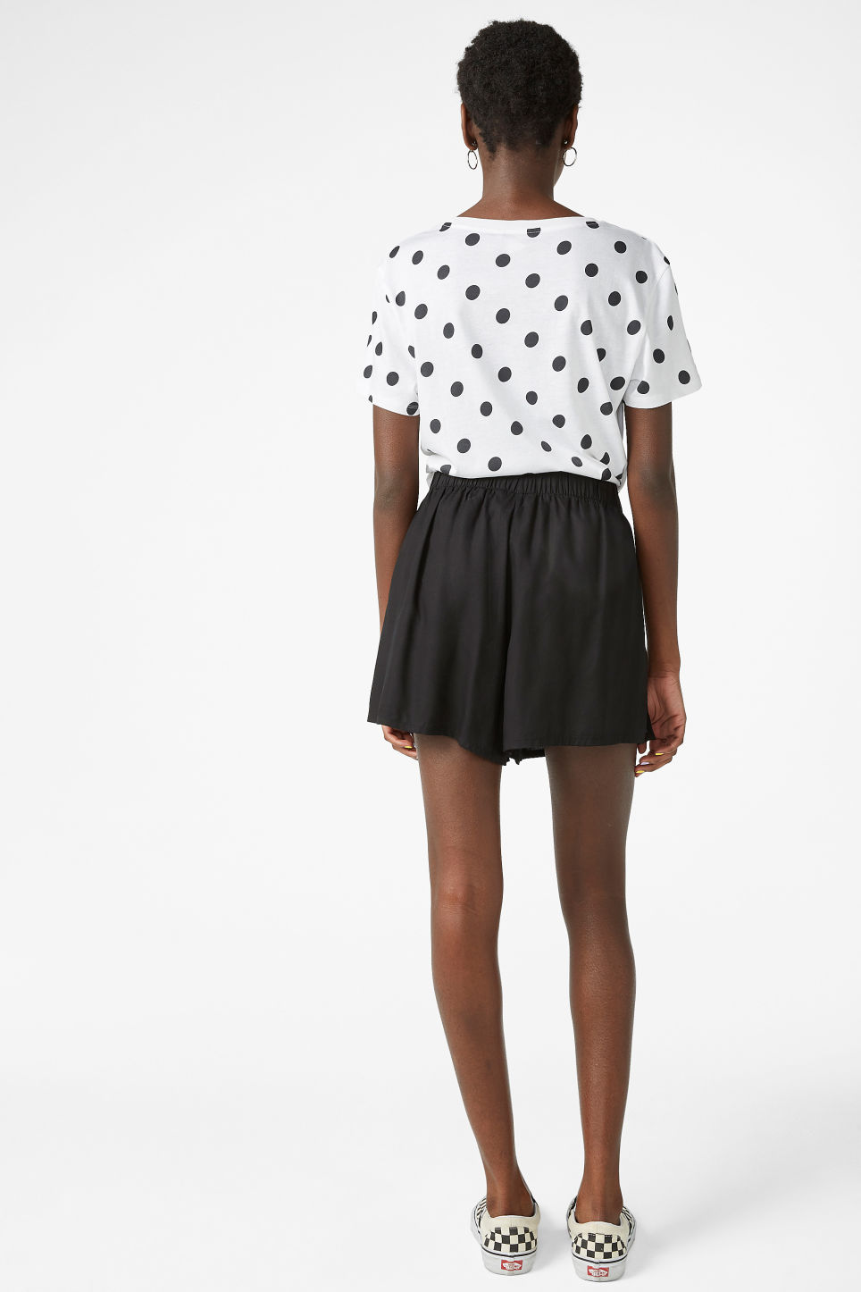 Model back image of Monki loose fit shorts in black