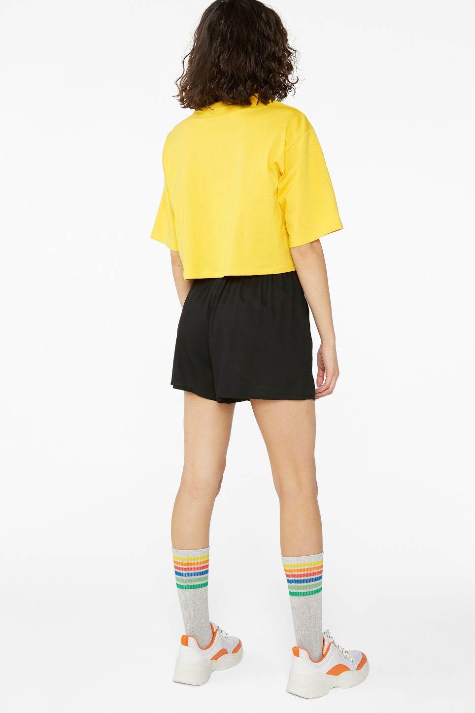 Model back image of Monki flowy shorts in black