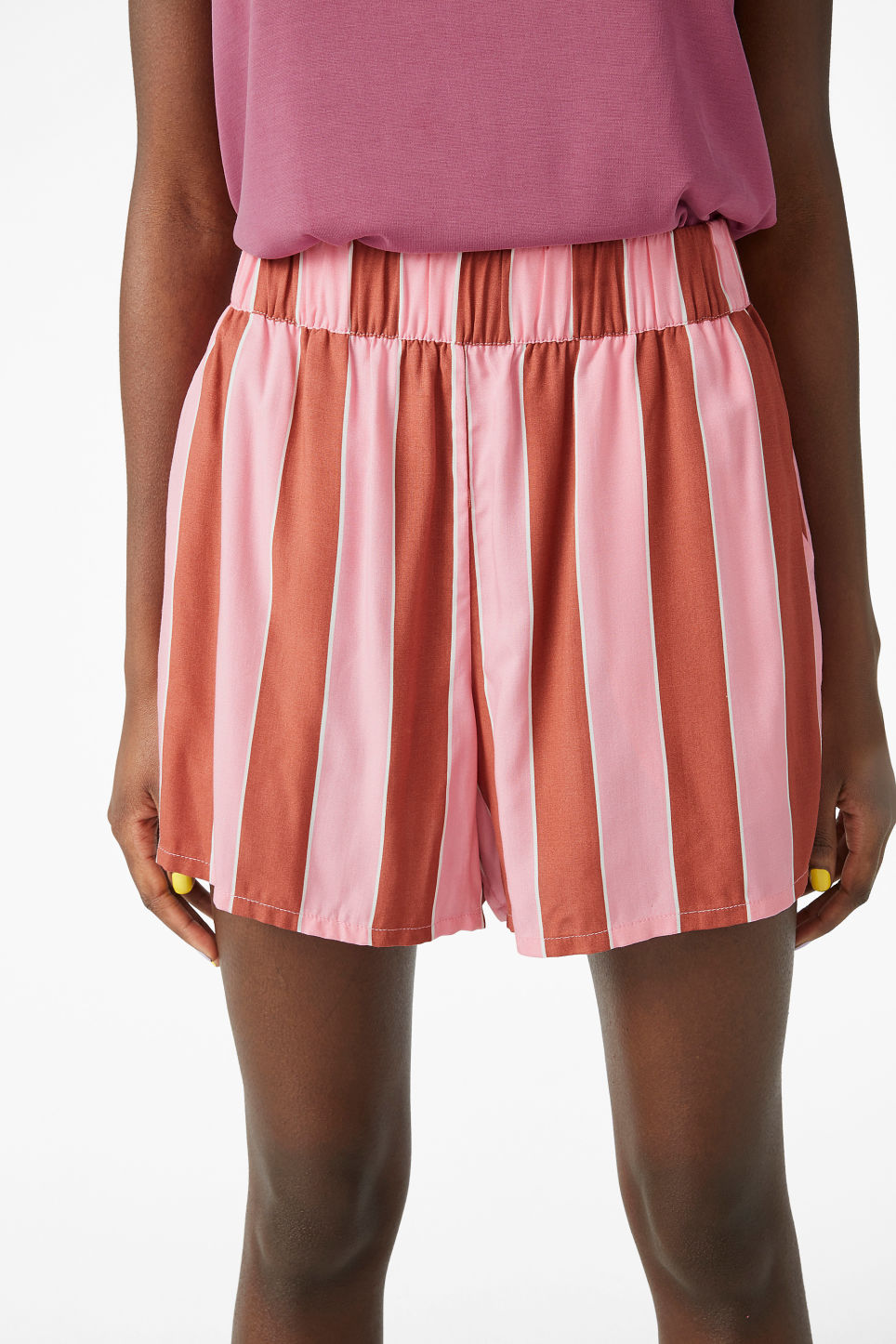 Model side image of Monki loose fit shorts in pink