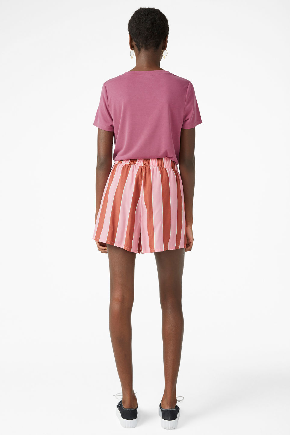 Model back image of Monki loose fit shorts in pink