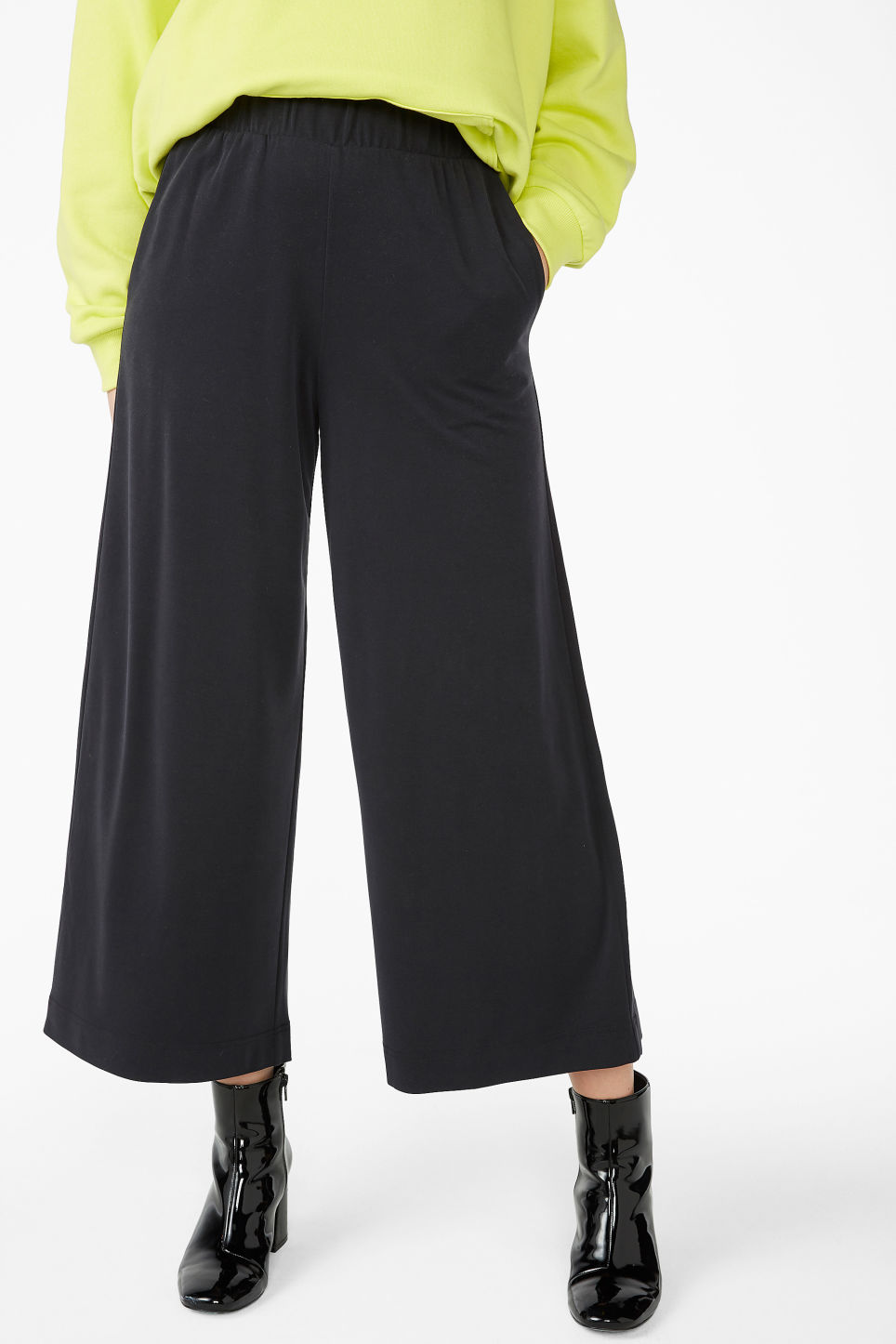 Model side image of Monki super-soft trousers in black